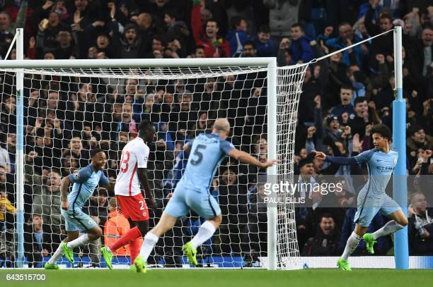 TOPSHOT Manchester City's German midfielder Leroy Sane celebrates scoring their fifth goal during the UEFA Champions League Round of 16 firstleg...