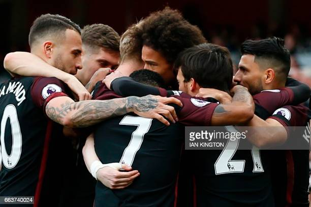 TOPSHOT Manchester City's German midfielder Leroy Sane celebrates with teammates after scoring the opening goal of the English Premier League...