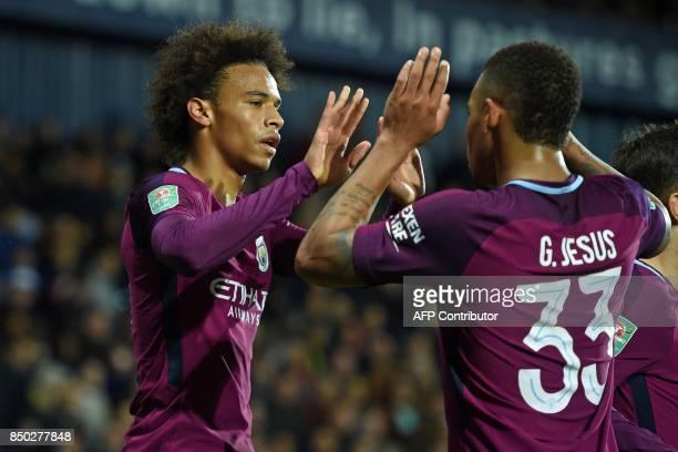 Manchester City's German midfielder Leroy Sane celebrates with Manchester City's Brazilian striker Gabriel Jesus after scoring their second goal...
