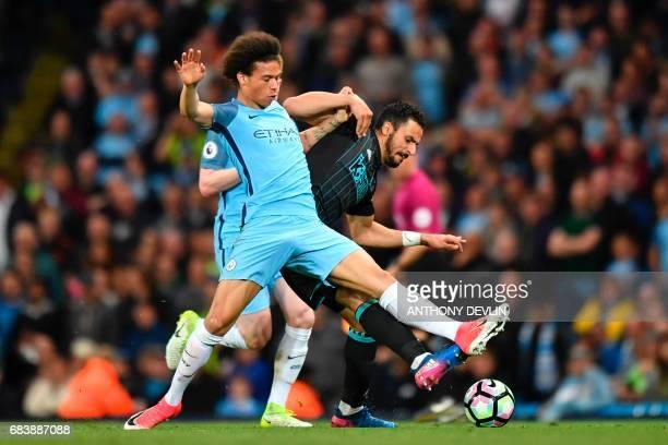 Manchester City's German midfielder Leroy Sane challenges West Bromwich Albion's Belgian midfielder Nacer Chadli during the English Premier League...