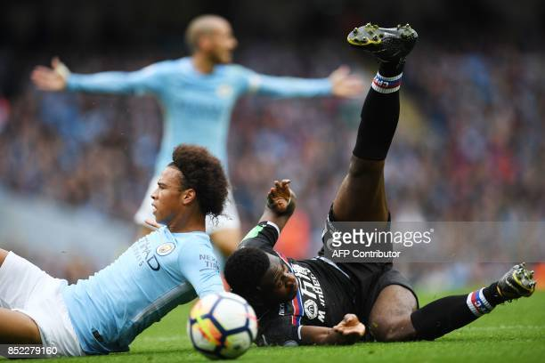 Manchester City's German midfielder Leroy Sane clashes with Crystal Palace's Dutch defender Timothy FosuMensah during the English Premier League...