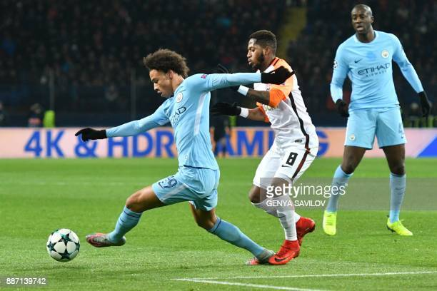 Manchester City's German midfielder Leroy Sane drives the ball ahead of Shakhtar Donetsk's Brazilian midfielder Fred during the UEFA Champions League...