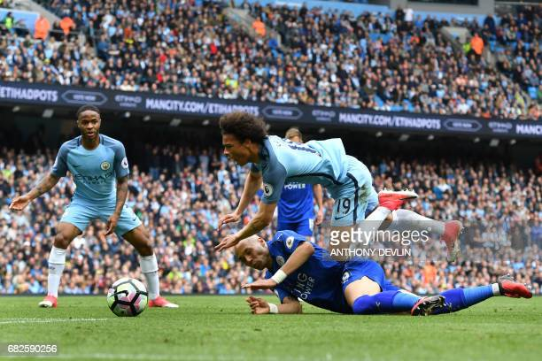 Manchester City's German midfielder Leroy Sane is brought down in the box by Leicester City's Algerian striker Islam Slimani to win a penalty during...