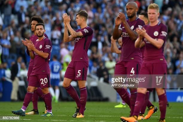 Manchester City's German midfielder Leroy Sane Manchester City's Portuguese midfielder Bernardo Silva Manchester City's English defender John Stones...