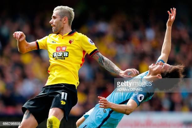 Manchester City's German midfielder Leroy Sane reacts after colliding with Watford's Yugoslavianborn Swiss midfielder Valon Behrami during the...