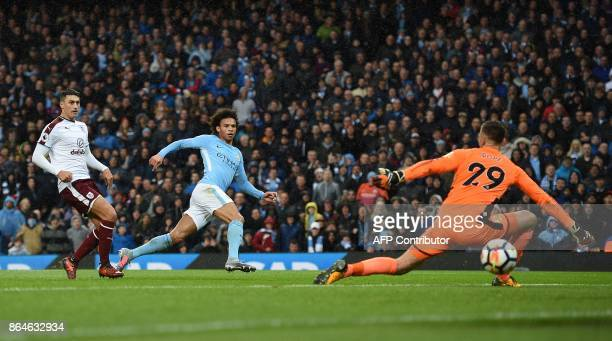 Manchester City's German midfielder Leroy Sane scores his team's third goal during the English Premier League football match between Manchester City...