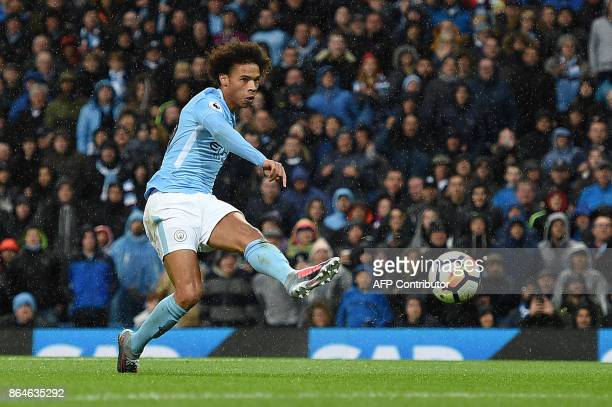 TOPSHOT Manchester City's German midfielder Leroy Sane scores his team's third goal during the English Premier League football match between...