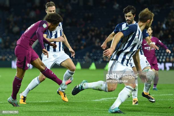 Manchester City's German midfielder Leroy Sane shoots to score their second goal during the English League Cup third round football match between...