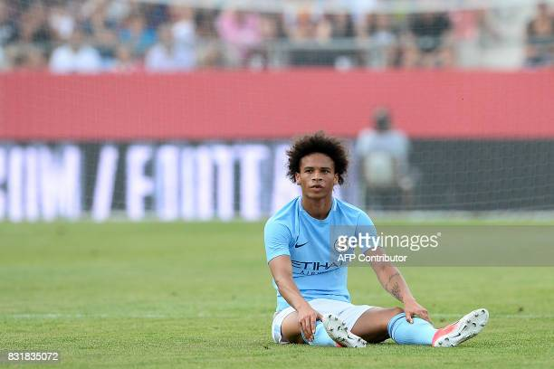 Manchester City's German midfielder Leroy Sane sits on the field during the Costa Brava trophy friendly football match between Girona FC and...