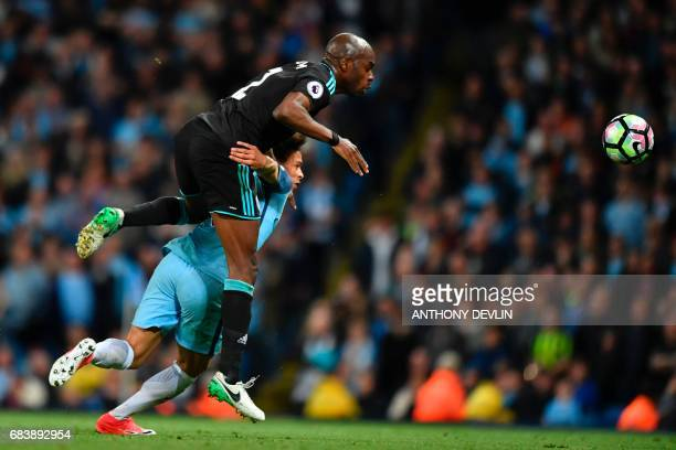 Manchester City's German midfielder Leroy Sane tangles with West Bromwich Albion's Frenchborn Cameroonian defender Allan Nyom during the English...