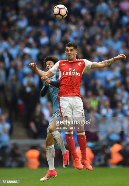 Manchester City's German midfielder Leroy Sane vies with Arsenal's Swiss midfielder Granit Xhaka during the FA Cup semifinal football match between...