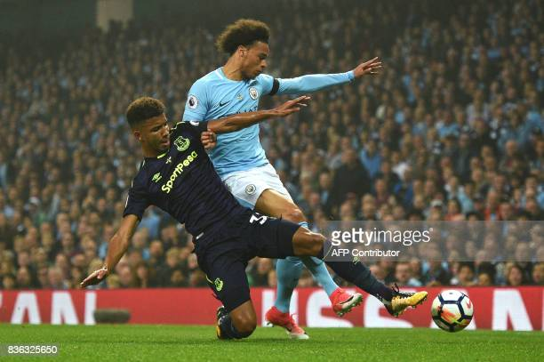 Manchester City's German midfielder Leroy Sane vies with Everton's English defender Mason Holgate during the English Premier League football match...