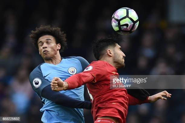 Manchester City's German midfielder Leroy Sane vies with Liverpool's German midfielder Emre Can during the English Premier League football match...