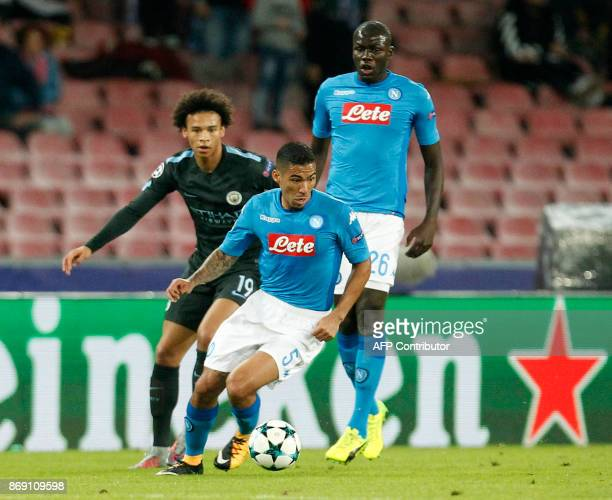 Manchester City's German midfielder Leroy Sane vies with Napoli's midfielder from Brazil Allan during the UEFA Champions League football match Napoli...