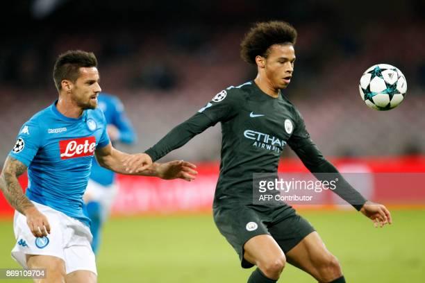 Manchester City's German midfielder Leroy Sane vies with Napoli's midfielder from Brazil Jorginho during the UEFA Champions League football match...