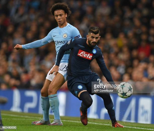 Manchester City's German midfielder Leroy Sane vies with Napoli's Albanian defender Elseid Hysaj during the UEFA Champions League Group F football...