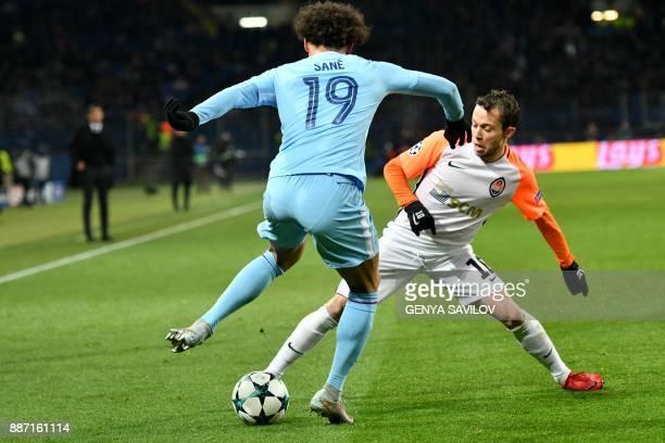 Manchester City's German midfielder Leroy Sane vies with Shakhtar Donetsk's Brazilian midfielder Bernard during the UEFA Champions League group F...