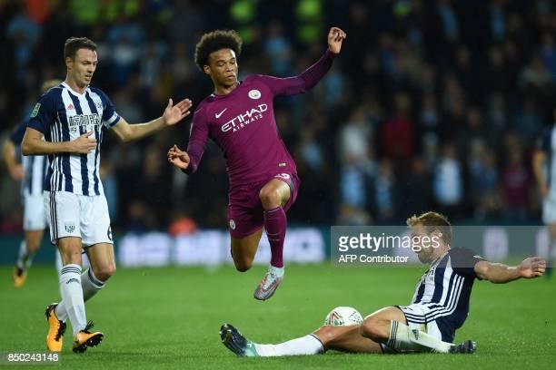 Manchester City's German midfielder Leroy Sane vies with West Bromwich Albion's Northern Irish defender Jonny Evans and West Bromwich Albion's...