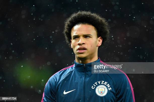 Manchester City's German midfielder Leroy Sane warms up for the English Premier League football match between Manchester United and Manchester City...
