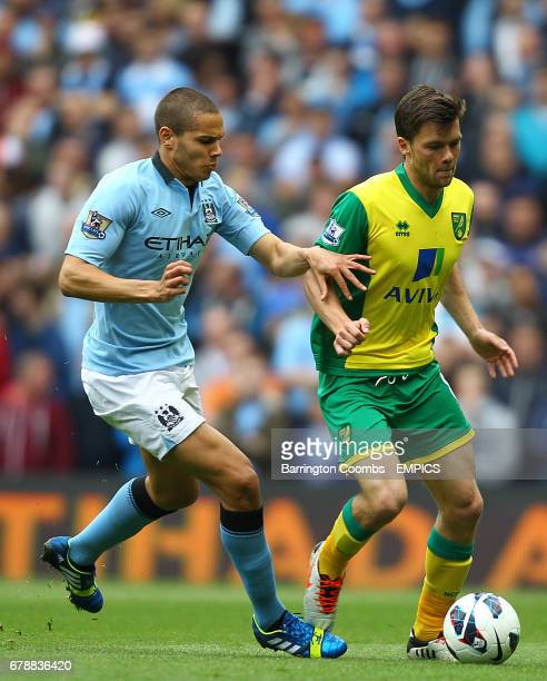 Manchester City's goal scorer Jack Rodwell and Norwich City's Jonny Howson in action
