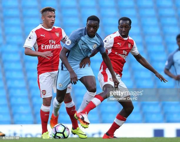 Manchester City's goal scorer Rodney Kongolo takes on the Arsenal defence