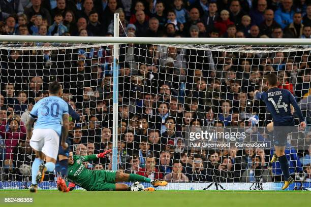 MANCHESTER ENGLAND OCTOBER Manchester City's goalkeeper Ederson saves the penalty by Dries Mertens during the UEFA Champions League group F match...