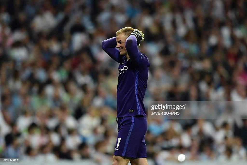 Manchester City's goalkeeper Joe Hart gestures during the UEFA Champions League semi-final second leg football match Real Madrid CF vs Manchester City FC at the Santiago Bernabeu stadium in Madrid, on May 4, 2016. Real Madrid won 1-0. / AFP / JAVIER