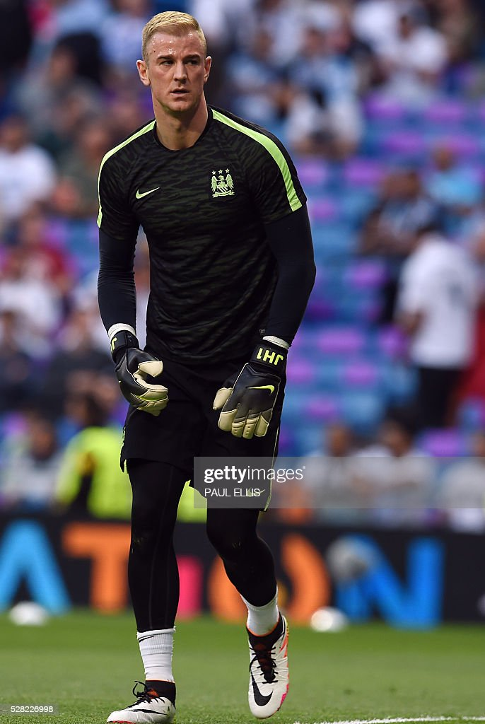Manchester City's goalkeeper Joe Hart warms up before the UEFA Champions League semi-final second leg football match Real Madrid CF vs Manchester City FC at the Santiago Bernabeu stadium in Madrid, on May 4, 2016. / AFP / PAUL