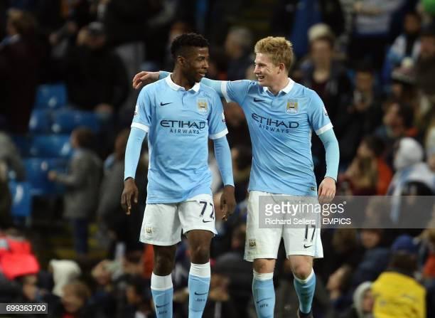 Manchester City's goalscorer's Kelechi Iheanacho left and Manchester City's Kevin De Bruyne celebrate