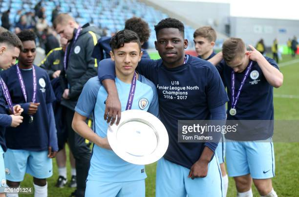 Manchester City's Iancarlo Poveda and Tom DeleBashiru celebrate winning the U18 Northern Premier League trophy