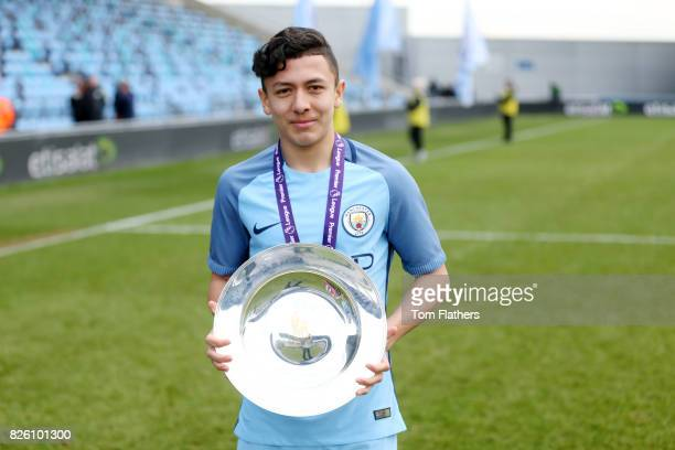Manchester City's Iancarlo Poveda celebrates winning the U18 Northern Premier League trophy