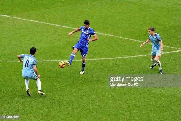 Manchester City's Ilkay Gundogan and John Stones and Chelsea's Diego Costa in action during the Barclay's Premiership match at the Etihad Stadium...