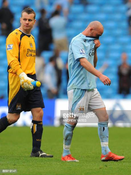 Manchester City's Irish midfielder Stephen Ireland and Manchester City's Irish goalkeeper Shay Given leave the pitch at the final whistle after being...