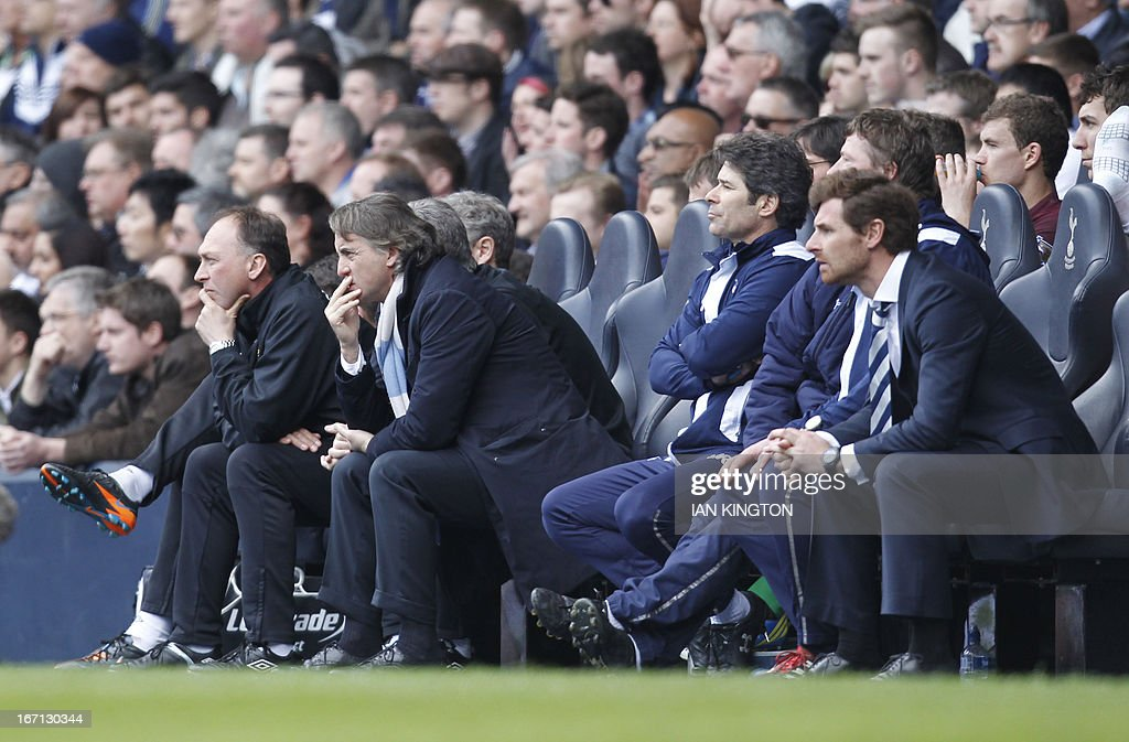"Manchester City's Italian manager Roberto Mancini (2L) and Tottenham Hotspur's Portugese manager Andre Villas-Boas (R) watch the action during the English Premier League football match between Tottenham Hotspur and Manchester City at White Hart Lane in north London on April 21, 2013. Tottenham won 3-1. AFP PHOTO / IAN KINGTON USE. No use with unauthorized audio, video, data, fixture lists, club/league logos or ""live"" services. Online in-match use limited to 45 images, no video emulation. No use in betting, games or single club/league/player publications"