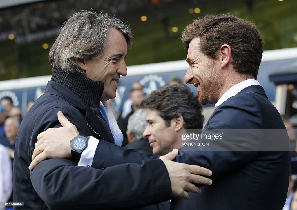 Manchester City's Italian manager Roberto Mancini (L) and Tottenham Hotspur's Portugese manager Andre Villas-Boas (R) greet each other before kick-off of the English Premier League football match between Tottenham Hotspur and Manchester City at White Hart Lane in north London on April 21, 2013. Tottenham won 3-1. USE. No use with unauthorized audio, video, data, fixture lists, club/league logos or live services. Online in-match use limited to 45 images, no video emulation. No use in betting, games or single club/league/player publications