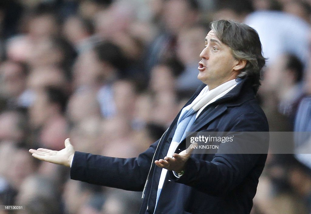 Manchester City's Italian manager Roberto Mancini gestures during the English Premier League football match between Tottenham Hotspur and Manchester City at White Hart Lane in north London on April 21, 2013. Tottenham won the game 3-1. USE. No use with unauthorized audio, video, data, fixture lists, club/league logos or live services. Online in-match use limited to 45 images, no video emulation. No use in betting, games or single club/league/player publications