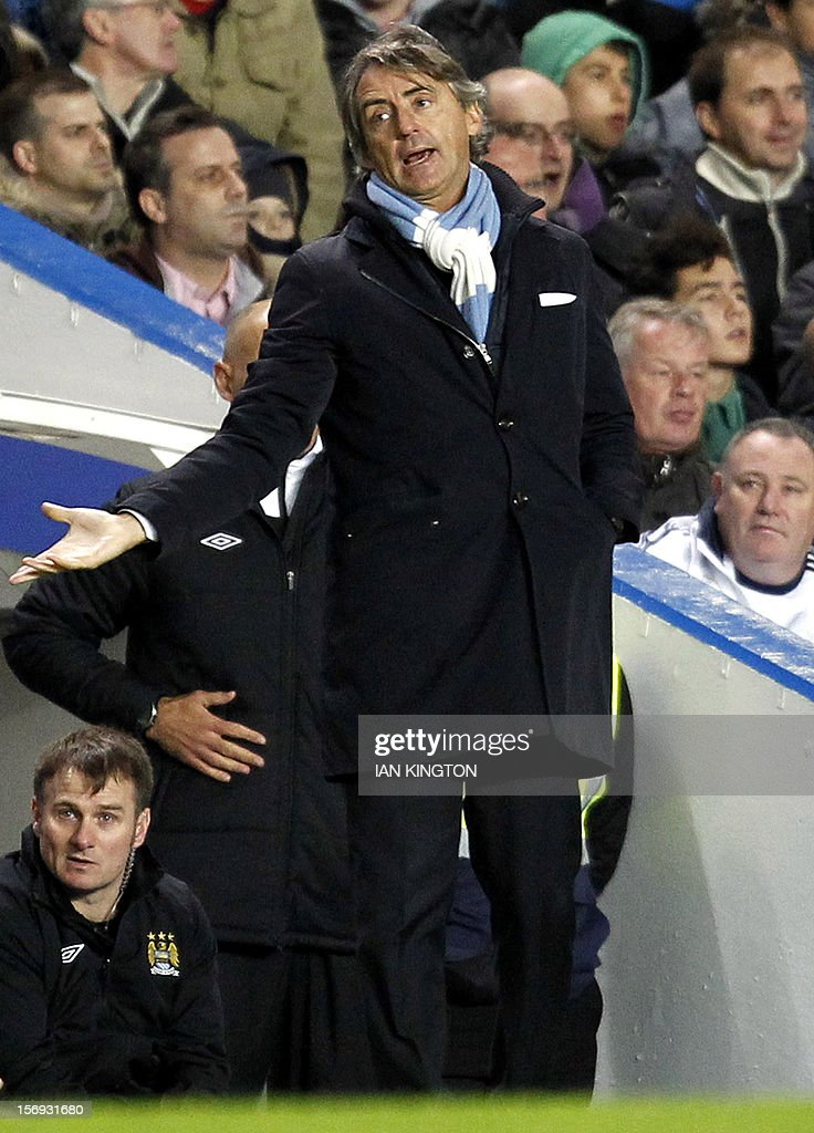 """Manchester City's Italian manager Roberto Mancini reacts during the English Premier League football match between Chelsea and Manchester City at Stamford Bridge in London on November 25, 2012. USE. No use with unauthorized audio, video, data, fixture lists, club/league logos or """"live"""" services. Online in-match use limited to 45 images, no video emulation. No use in betting, games or single club/league/player publications"""