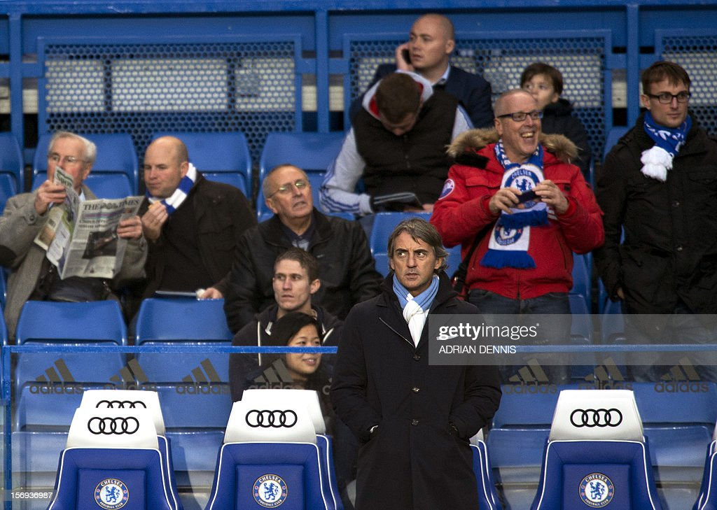 Manchester City's Italian manager Roberto Mancini waits for the start of the English Premier League football match between Chelsea and Manchester City at Stamford Bridge in London on November 25, 2012. The game ended 0-0. USE. No use with unauthorised audio, video, data, fixture lists, club/league logos or 'live' services. Online in-match use limited to 45 images, no video emulation. No use in betting, games or single club/league/player publications.