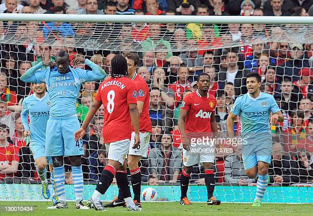 Manchester City's Italian striker Mario Balotelli celebrates scoring the opening goal of the English Premier League football match between Manchester...