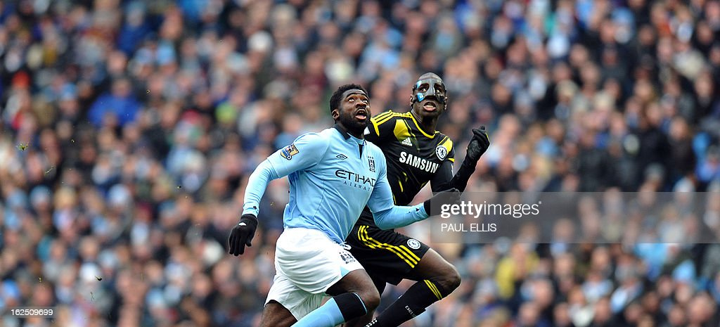"""Manchester City's Ivorian defender Kolo Toure vies with Chelsea's french-born Senegalese striker Demba Ba (R) during the English Premier League football match between Manchester City and Chelsea at the Etihad Stadium in Manchester, northwest England, on February 24, 2013. USE. No use with unauthorized audio, video, data, fixture lists, club/league logos or """"live"""" services. Online in-match use limited to 45 images, no video emulation. No use in betting, games or single club/league/player publications."""