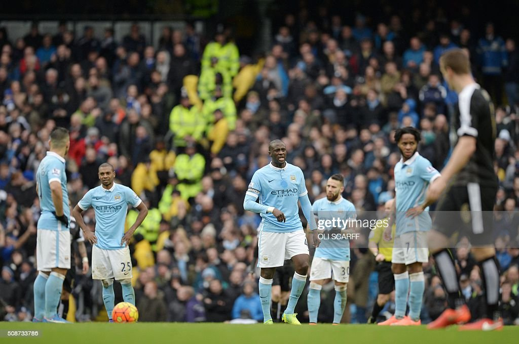 Manchester City's Ivorian midfielder and captain Yaya Toure (C) and teammates react after Leicester City's Algerian midfielder Riyad Mahrez (not pictured) scored his team's second goal during the English Premier League football match between Manchester City and Leicester City at the Etihad Stadium in Manchester, north west England, on February 6, 2016. / AFP / OLI SCARFF / RESTRICTED TO EDITORIAL USE. No use with unauthorized audio, video, data, fixture lists, club/league logos or 'live' services. Online in-match use limited to 75 images, no video emulation. No use in betting, games or single club/league/player publications. /