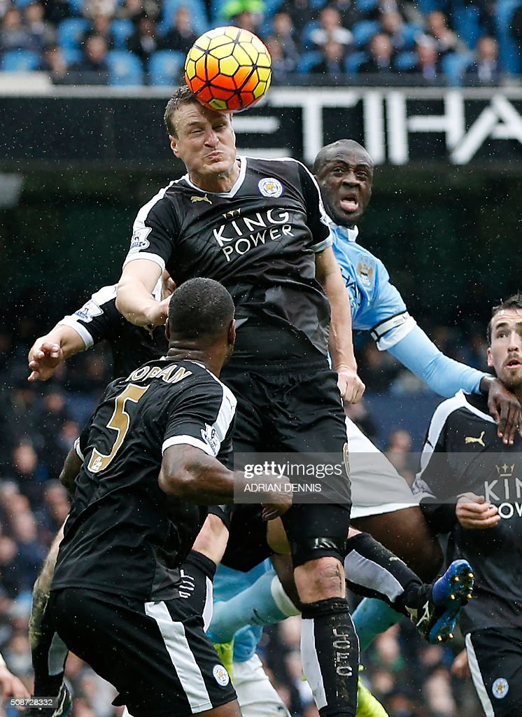 Manchester City's Ivorian midfielder and captain Yaya Toure (R) vies with Leicester City's German defender Robert Huth (L) in the air during the English Premier League football match between Manchester City and Leicester City at the Etihad Stadium in Manchester, north west England, on February 6, 2016. / AFP / ADRIAN DENNIS / RESTRICTED TO EDITORIAL USE. No use with unauthorized audio, video, data, fixture lists, club/league logos or 'live' services. Online in-match use limited to 75 images, no video emulation. No use in betting, games or single club/league/player publications. /