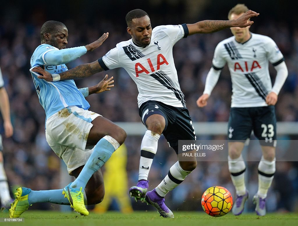 Manchester City's Ivorian midfielder and captain Yaya Toure (L) vies with Tottenham Hotspur's English defender Danny Rose during the English Premier League football match between Manchester City and Tottenham Hotspur at the Etihad Stadium in Manchester, north west England, on February 14, 2016. / AFP / PAUL ELLIS / RESTRICTED TO EDITORIAL USE. No use with unauthorized audio, video, data, fixture lists, club/league logos or 'live' services. Online in-match use limited to 75 images, no video emulation. No use in betting, games or single club/league/player publications. /