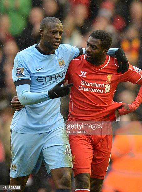 Manchester City's Ivorian midfielder Yaya Toure and Liverpool's Ivorian defender Kolo Toure leave the pitch at the final whistle in the English...