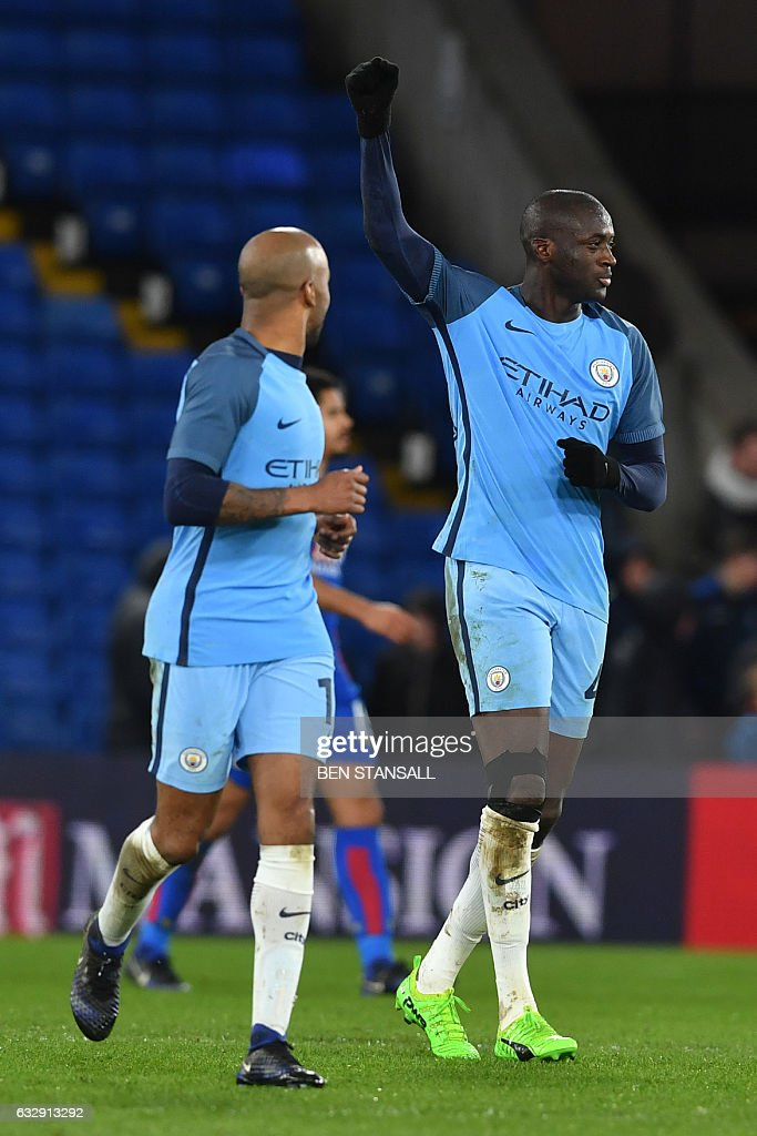 Manchester City's Ivorian midfielder Yaya Toure (R) celebrates scoring their third goal during the English FA Cup fourth round football match between Crystal Palace and Manchester City at Selhurst Park in south London on January 28, 2017. / AFP / Ben STANSALL / RESTRICTED TO EDITORIAL USE. No use with unauthorized audio, video, data, fixture lists, club/league logos or 'live' services. Online in-match use limited to 75 images, no video emulation. No use in betting, games or single club/league/player publications. /