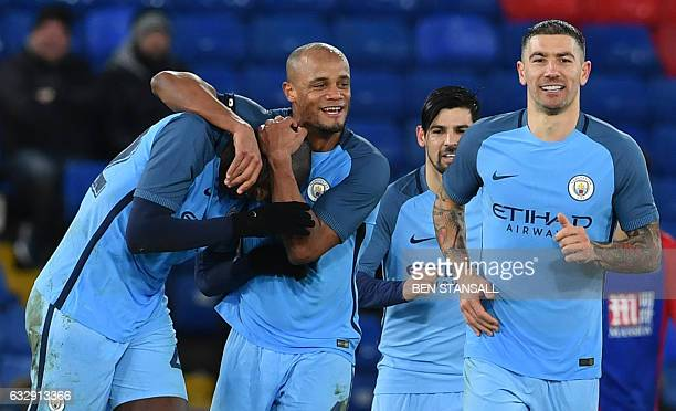 Manchester City's Ivorian midfielder Yaya Toure celebrates scoring their third goal with Manchester City's Belgian defender Vincent Kompany during...