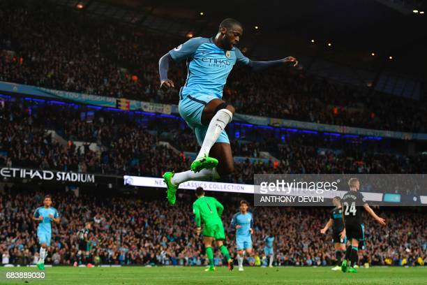 Manchester City's Ivorian midfielder Yaya Toure celebrates scoring their third goal during the English Premier League football match between...