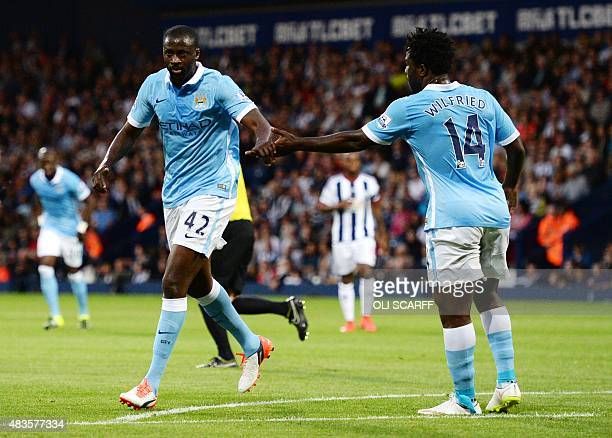 Manchester City's Ivorian midfielder Yaya Toure celebrates with Manchester City's Ivorian striker Wilfried Bony after scoring his second goal during...