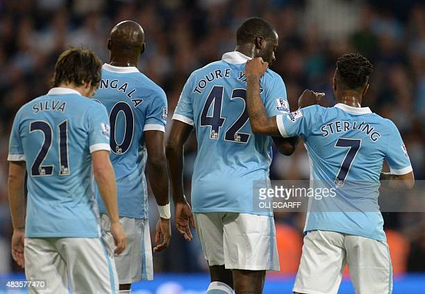 Manchester City's Ivorian midfielder Yaya Toure celebrates with Manchester City's English midfielder Raheem Sterling after scoring his second goal...