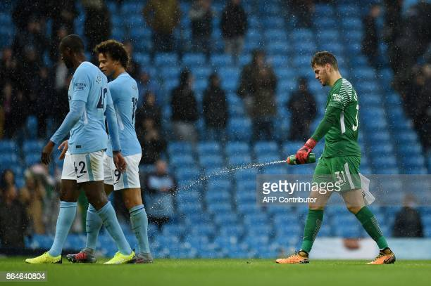 Manchester City's Ivorian midfielder Yaya Toure Manchester City's German midfielder Leroy Sane and Manchester City's Brazilian goalkeeper Ederson...